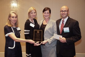 FLY founders Julia and Peter Saulino (at right) accept the 2015 Audesse Award from the Massachusetts Society of Clinical Oncologists.